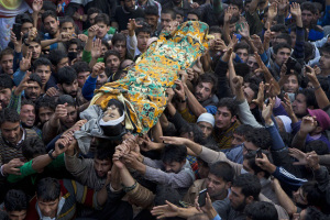 Kashmiri Muslim villagers carry the body of suspected militant Nissar Ahmed Wani, during his funeral procession in Adipora, northwest of Srinagar, Indian controlled Kashmir, Wednesday, Oct. 21, 2015. Indian government forces killed a suspected rebel in a gunbattle Wednesday in the disputed Himalayan region of Kashmir, officials said. (AP Photo/Dar Yasin)